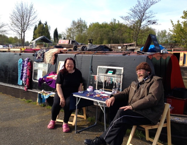 "Lesley and Ray 'Morgana"" with hand-made jewelry, head bands, hats, and scarves"