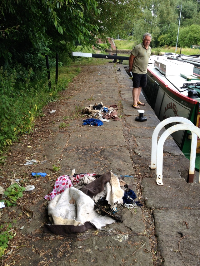 Piles of discarded crap from other boaters, left thoughtlessly at the lock-side