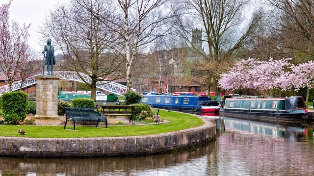 Spring blossom at the junction of the Trent & Mersey and the Caldon Canal with James Brindley on his perch