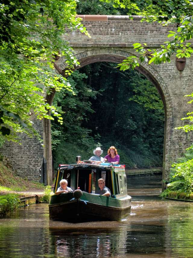 A family on a day boat meandering along the Shroppie