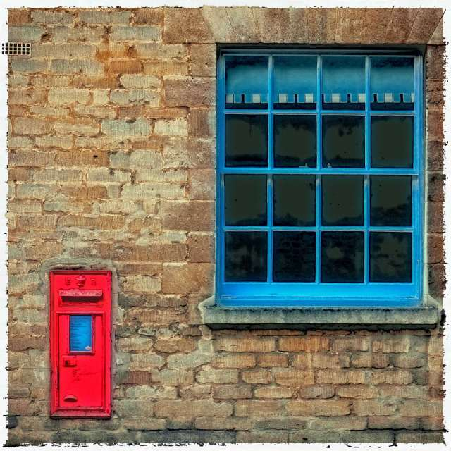 I love the way the post boxes are just stuck in the side of people's houses