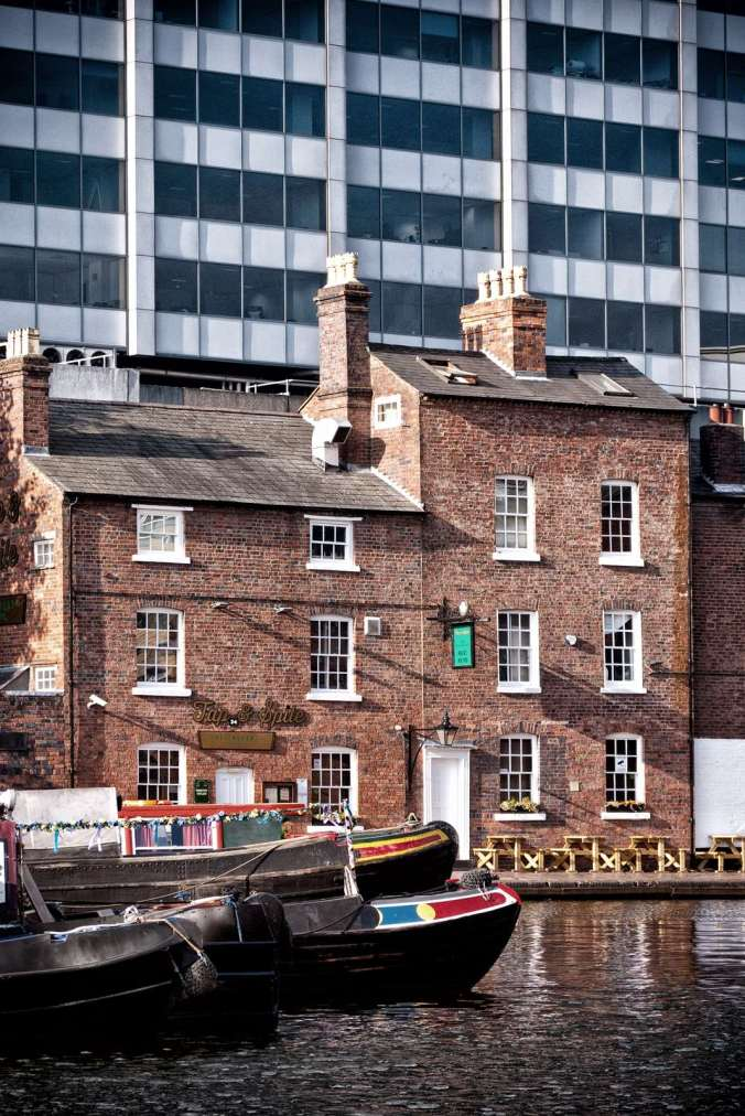 'The Tap and Spile' pub and 'Gas Street Basin' look a little overwhelmed by the modern city