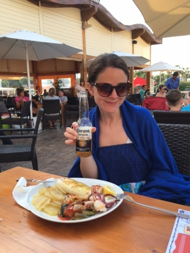 Lisa enjoying octopus, squid and a Corona