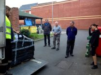 The pallets unloading at the rear of the store