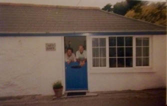 Mum and dad look out over the stable door of The Net Loft