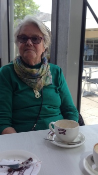 Mum enjoying a coffee and cake the last time I was with her just over two weeks ago